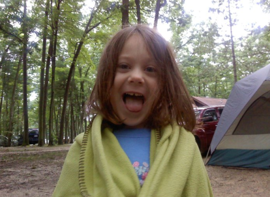 Photographic proof that she enjoyed camping...despite rain and sleeping on the ground in a tent. Look at the happy! She was so cute!