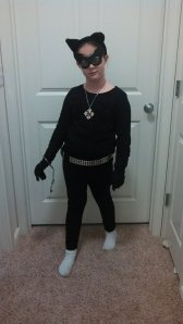 "Eight Years Old - Catwoman (this was all her...she got handcuffs, a cool necklace that she ""stole"" the belt...so fun!)"