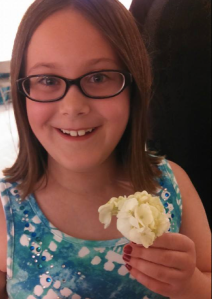 My beautiful Kidlet. Picture from this past June at a wedding. She caught part of the bouquet!)